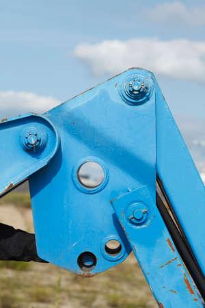 건설 차량에서 파란색 유압 팔 스톡 콘텐츠