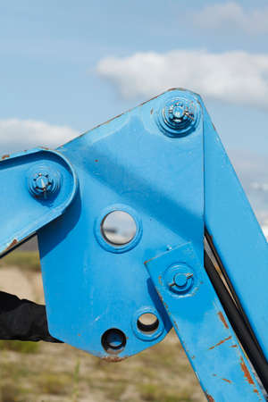 Blue hydraulic arm from a construction vehicle Stock Photo