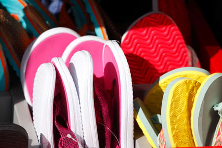 Colourful summer sandals at a shoe stand