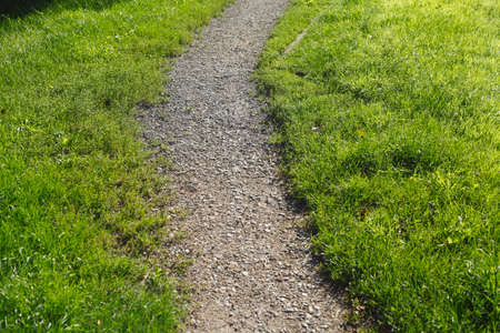 Grit way, footpath and meadow