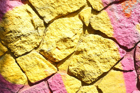 yellow colored brick wall Stock Photo