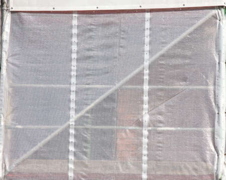 scaffold and Cover tarpaulin on a Construction Site