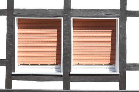 White Plastic Windows on a half-timbered house with  pulled down shutters Reklamní fotografie - 91185337