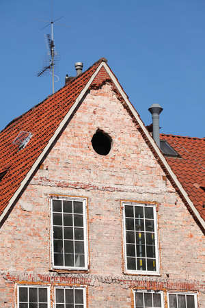 Old House roof gable with Windows from brick