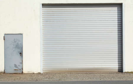 Garage Gate on a white harbor scale building