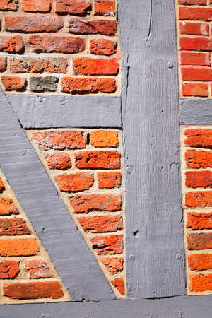 Brick wall with half-timbered beams, old town, Stade, Lower Saxony, Germany