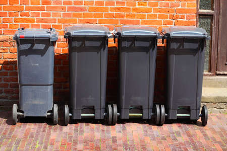Recycling bins, rubbish bins for residual waste standing on the sidewalk, Germany, Europe Reklamní fotografie