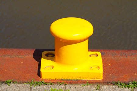 Yellow bollard, bollard in the harbor