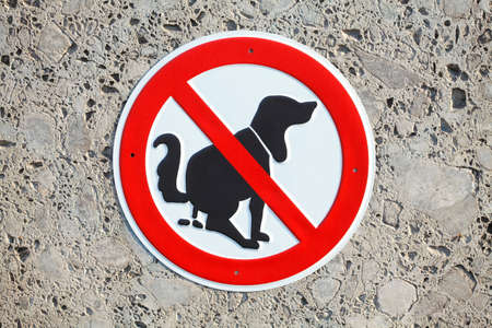 Prohibition sign dog kotan of a house wall, Germany