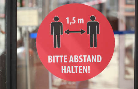 Sign Please keep your distance, minimum distance due to corona virus, Germany, Europe