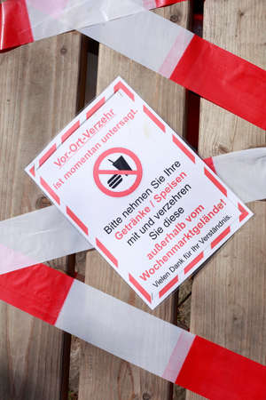 Barrier tape, sign prohibiting consumption due to corona virus, Germany, Europe
