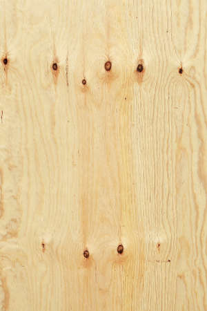 brown wooden wall on a construction fence with knotholes Stock Photo