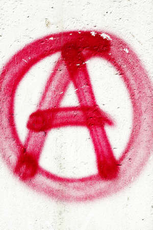 Red A for anarchy painted on white wall
