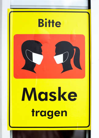 Sign wearing mask, mask requirement due to corona virus, Germany, Europe