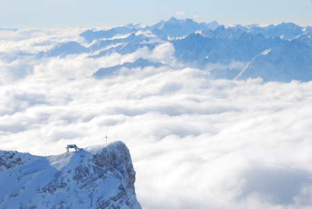 The crucifix on Zugspitze, Germany Stock Photo