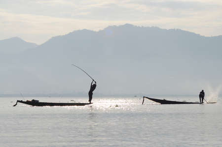 Silhouette of the fishermen