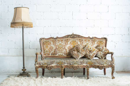 Vintage luxury sofa with lamp in white room photo