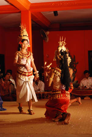 headress: SIEM REAP, CAMBODIA - MAY 3   Khmer classical dancers performing in full traditional costume May 3, 2009 in Siem Reap, Cambodia Angkor Wat is the most visited place in Cambodia