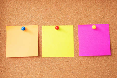 Colorful sticky notes on cork board photo