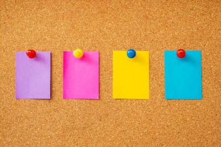 Colorful sticky notes on cork board  photo