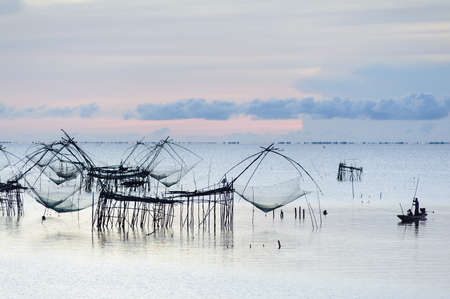 Fisherman and the sea, Thailand  photo