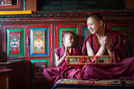 KATHMANDU - SEPTEMBER 24   Unidentified buddhist monks are praying in Bodhnath monastery on September 24, 2012 in Kathmandu Valley, Nepal