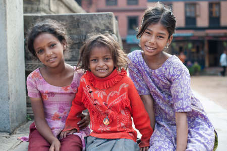 BHAKTAPUR, NEPAL - SEP 29   Unidentified smiling girls on September 29, 2012 in Bhaktapur, Nepal  Bhaktapur is listed as a World Heritage by UNESCO for its rich culture, temples, and wood artwork