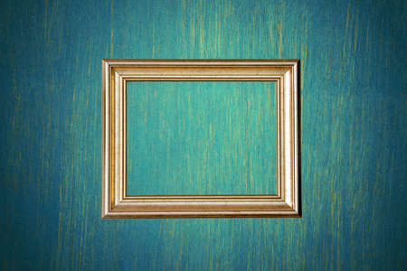 Gold photo frame on green wall photo