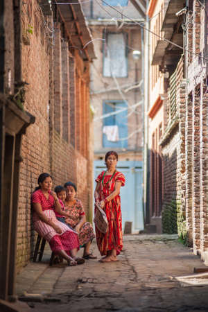 BHAKTAPUR, NEPAL - SEP 29   Unidentified Nepali women on September 29, 2012 in Bhaktapur, Nepal  Bhaktapur is listed as a World Heritage by UNESCO for its rich culture, temples, and wood artwork