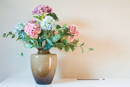 Artificial flower in vase photo