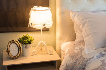 Romantic lamp at the bed photo