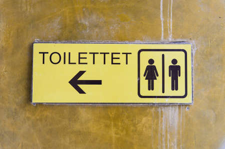a public notice: Man and a lady toilet sign