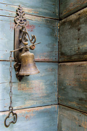 bronz: Old bell on the wall Stock Photo