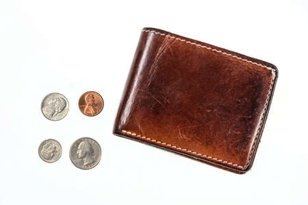denominational: US coins spilling out of open leather wallet Stock Photo
