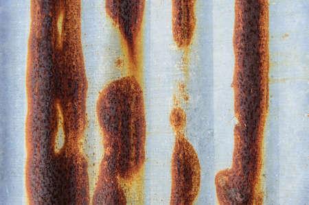 worn: worn red peeled rusty wall Stock Photo