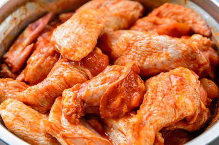 spiced: Raw spiced Chicken Wings before cokking