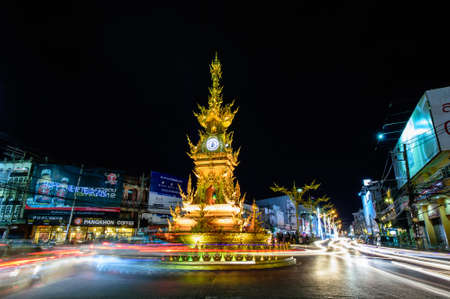CHIANGRAI, THAILAND - DECEMBER 27 2015 : Golden Clock Tower , built in typical Thai style. Designed by Chalermchai Khosit Pipat - The best Thai visual artist in Chiangrai, Thailand.