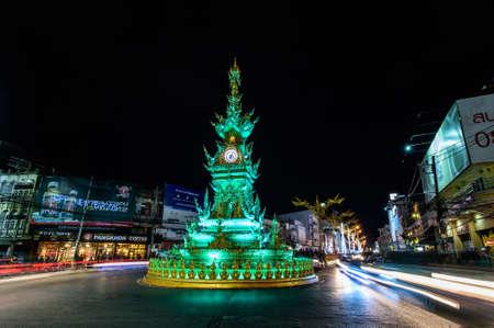 CHIANGRAI, THAILAND - DECEMBER 27 2015 : Golden Clock Tower , built in typical Thai style. Designed by Chalermchai Khosit Pipat - The best Thai visual artist in Chiangrai, Thailand.