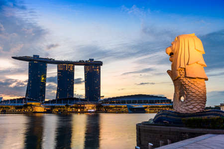 SINGAPORE - NOVEMBER 23, 2016: silhouette of Merlion Statue at Marina Bay against the sunrise. Merlion is a well known marketing icon of Singapore depicted. Editorial