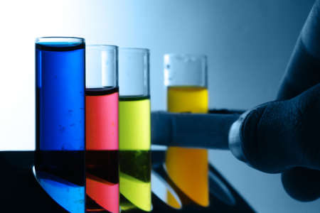 inventing: test tubes with colorful substances                       Stock Photo