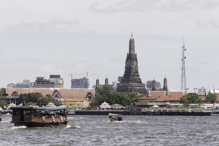 Wat Arun Ratchawararam Ratchawaramahawihan and Chao Phraya river photo