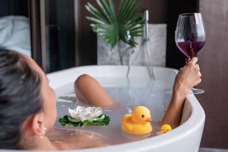 Girl posing while lying in a foam bath