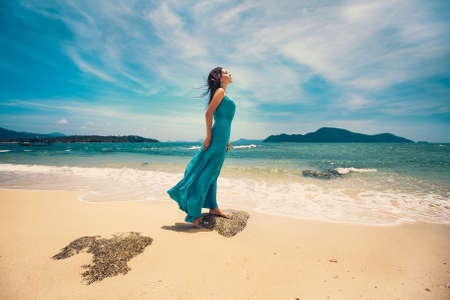 Attractive girl resting on a tropical island