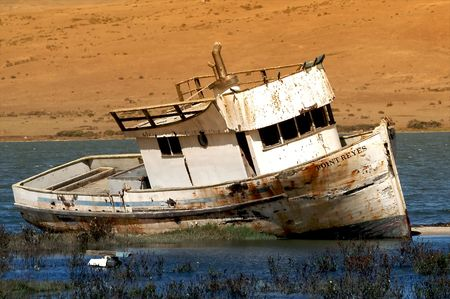 ship wreck: Boat without water