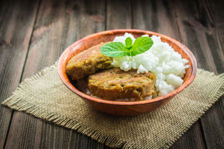 cutlets: Cutlets with white rice in a bowl.