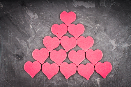 heartfelt: red and pink hearts on grey background Stock Photo