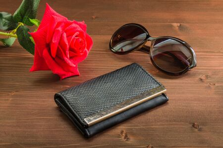 black womens purse on a wooden background. Stock Photo