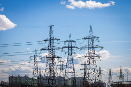 High-voltage power lines in the background of the city. Electric distribution station Stock Photo