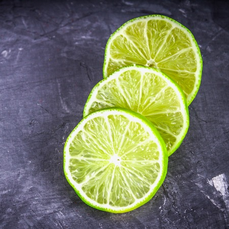 light slate gray: Slices of lime on a gray marble background.