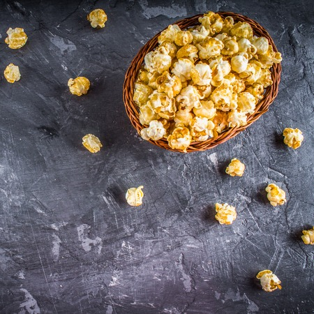 buttered: popcorn on a gray background.